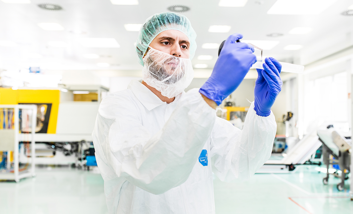 cleanroom worker at rose plastic medical packaging.